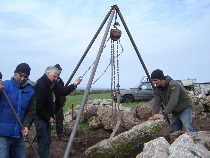 Using the tripod in the traditional way to raise a granite gatepost.
