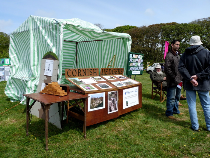 A breezy day with the Guild's tent at a local event.  Robin designed and made the folding display stand for compact storage and ease of handling.  It suits the Guild's modest, workmanlike ethos.